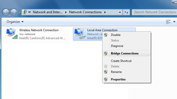 The Network Connections window, with the Local Network Connection selected and its context menu displayed. 'Bridge Connections' is selected on the context menu.