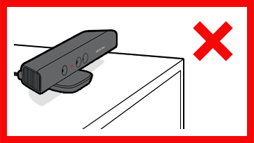 A Kinect sensor showing a red LED is positioned some distance back from the front edge of a cabinet. A red 'X' is next to the image.