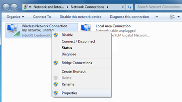 The Windows Network Connections window, with a Wireless Network Connection selected and its context menu displayed