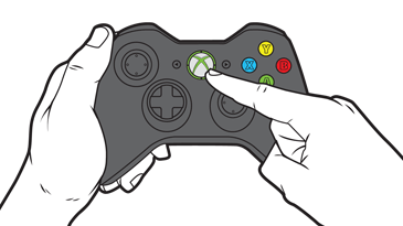 A finger reaches to press the Guide button on an Xbox 360 controller.