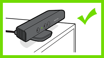 A Kinect sensor showing a green LED is positioned near the front edge of a cabinet. A check mark is next to the image.